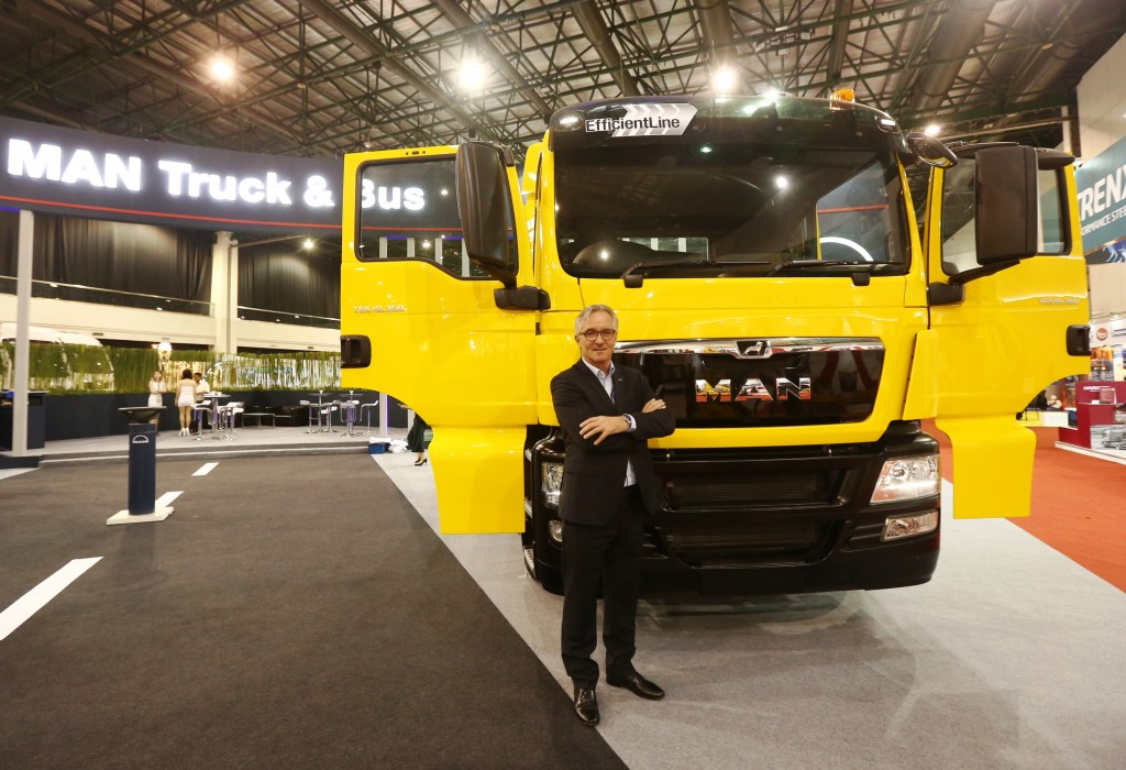 Hartmut Mueller, Managing Director of MAN Truck and Bus (M) Sdn Bhd with the MAN Efficient Line truck at the Malaysia Commercial Vehicle Expo 2017.